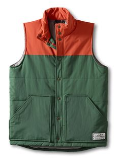 KAVU Switchback-Hunter Green-Vintage inspired insulated vest, color blocked with contrast nylon liner and 140gsm polyester fill, fleece lined chest and two lower patch pockets, curved back hem, antique brass snaps and thick thread. Fabric: 100% nylon – WR 600mm clear coating.