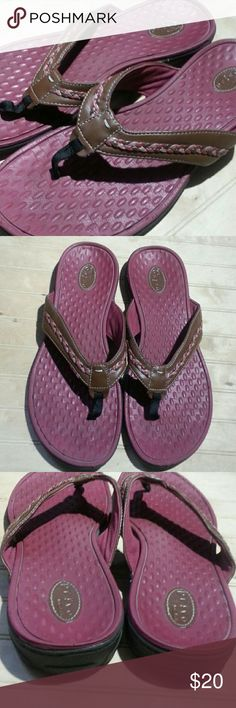 Clarks Privo Sandals These are the most comfortable pair of flip flops. They have leather straps with a decorative braid. The insole massages the foot as you walk. The underside of the straps are a bit faded and discolored, but the outside looks great. Clarks Shoes Sandals