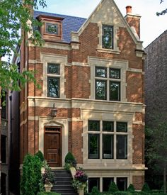 CURB APPEAL – another great example of beautiful design. English City House Exterior with traditional exterior in chicago by Burns and Beyerl Architects.