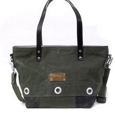 """Navy Kitbag Tote Shoulder Bag //  Recycled and by peace4youBAGS         An upcycled bag made of a german navy kitbag and a used leather-jacket . The whole bag will be closed by a zipper. """" 5-Pocket Bag !"""" Inside there are five useful pockets, two of them are closed by a zipper."""