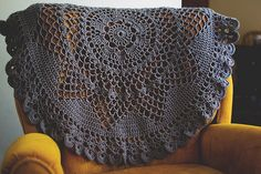 Beautiful....a lovely use for some of those old doily patterns, enlarged by the use of hickier threads and larger hooks, make beautiful lap blankets just to take the chill off, or to spruce up a tatty chair or sofa by laying it on a chair back like this.