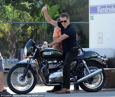 Easy Rider: The 60-year-old was ready to roll in black jeans, a dark blue v-neck T-shirt and brown shoes, while he made sure to don obligatory cool black shades