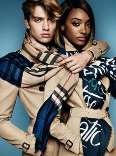 Scarves in runway prints and colour block check, worn by Jourdan Dunn and George Le Page for Burberry S/S15