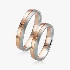 En or blanc et rose, le Duo Aloysia & Aliette est sobre et élégant. Un diamant centrale rond vient compléter e modèle féminin. http://www.zeina-alliances.com/alliance-duo/3729-duo-aloysia-aliette.html