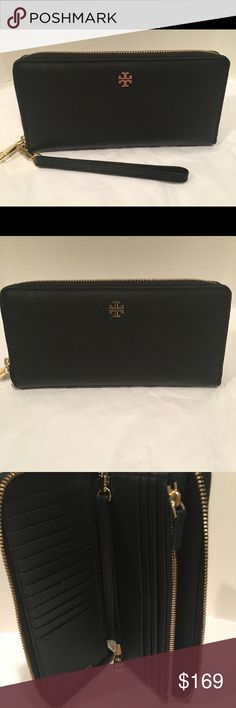 """Tory Burch York Zip Passport Continental Wallet 100% Authentic ! Brand New . Comes with original tags! Available in Black, Luggage, or Light Oak . Please see our closet for the luggage or light oak colors This timeless wallet/wristlet features multiple compartments for essentials and a convenient wrist strap for those who are on the go. Removable wrist strap 5.5"""" . Zip around closure. Saffiano Leather. Interior zip compartment, 3 interior open pockets, 18 credit card slots, leather lining…"""