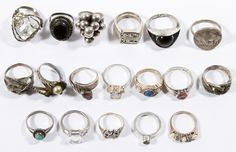 Lot 527: Sterling Silver Ring Assortment; Eighteen rings; some having semi-precious gemstones; some stamped sterling marks