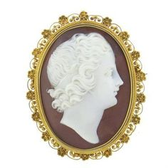 Antique brooch/ pendant, featuring cameo as a centerpiece, surrounded with beautiful filigree 14k gold frame. DESIGNER: Not Signed MATERIAL: 14K Gold GEMSTONE: Cameo DIMENSIONS: Brooch measures 41mm x
