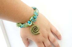 This bracelet is gorgeous! It is made with blue agate, opals, peridot, swarovski crystal and apatite. All the gemstones are genuine. Green and blue, it brings to mind the rolling seas. Handmade Bracelets, Handmade Jewelry, Unique Jewelry, Nautilus Shell, Stylish Plus, Shell Bracelet, Bee Design, Peridot, Swarovski Crystals