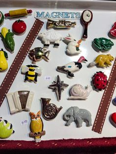 Sweet ceramic pins and magnets in every shape - even accordions! By Gary Becker, in space 161 on Wizard Way. See http://www.holidaymarket.org for shopping info