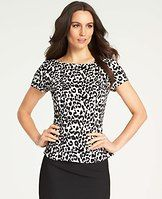 Leopard Print Peplum Top - Animal magnetism: this impeccably-fitted peplum top flaunts a bold black and white leopard print for a touch of perfectly prowly style. Paired with a sleek pencil skirt, it's nothing short of fierce. Jewel neck. Short sleeves. Peplum hem.