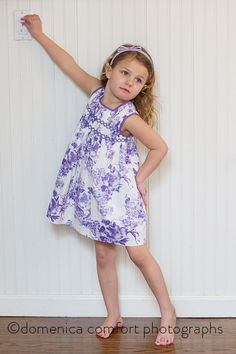 Another one of our customers wearing our own line! This adorable purple and white delicately smocked  summer dress is another design by Adrian East. Great style, quality and value - always - at ADRIAN EAST. You'll find this already out on our selling floors and on our website, www.ADRIANEAST.com ADRIANEAST.COM  #summerdress #girlsdresses #smocking #smockeddresses