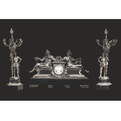 A French silvered bronze and black marble clock garniture Paris, last quarter 19th century.
