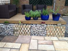 stone and log filled gabions in Co Durham garden. http://www.gabion1.co.uk
