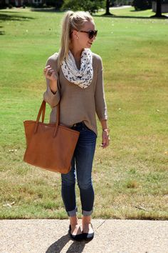 Tan oversized sweater, rolled skinny jeans, black flats
