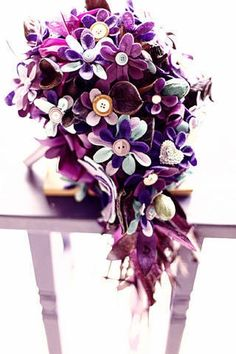 This bride had a cascade of cut-out purple felt fabric flowers accented with buttons, potpourri, and ribbons. That is impressive!