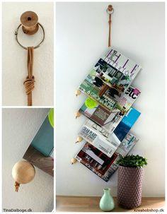 Lav selv en holder til blade og magasiner, der kan hænges på en væg. Materialer: trækugler lædersnøre og bogring er fra Kreahobshop.dk