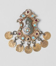 A wonderful and elaborate Armenian made pendant in gilt silver, jade, turquoise, and rubies.  Likely 18th - early 19th century.  From the Ottoman era and made in Turkey.  From the Philadelphia museum.