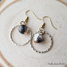 Black and clear crackle glass dangle mixed metal earrings