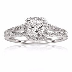 14kt white gold cushion cut diamond engagement ring with pave halo and split shank!