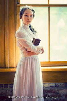 © Susan Fox / Trevillion Images - young-historical-girl-holding-book-inside