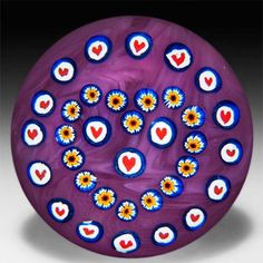 John Gentile heart canes and patterned millefiori on pink cushion ground glass paperweight. by John Gentile
