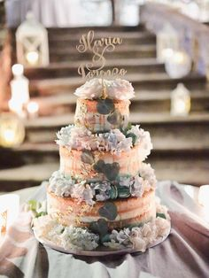 Beautiful naked drip cake with florals