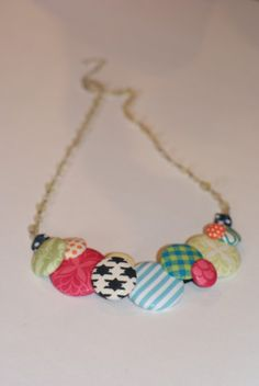 A lovely fabric necklace made with a vintage jewelry chain and fabric covered buttons. #buttons#necklace#fabric