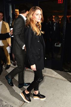 Olivia Palermo is on-trend per usual and we're obsessing over the ultra-cool way she styles her statement Stella McCartney platform oxfords with a simple long black blazer and leather pants.