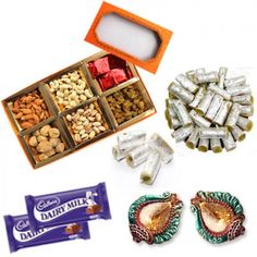 Mix Dryfruit Kaju Roll and Chocolates Hampers Treat 2 Decorated Diwali Diyas combo, Sweet Gift for everyone in this hamper.Treat your loved ones to a rich assortment of uniquely blended.This is a item thus slight variation may occur in terms of color and design.  mix Dryfrits - 75gms each  kaju Rolls - 200gms Diwali Diyas - 2 Pairs Dairy Milk Chocolates - 2 Pcs