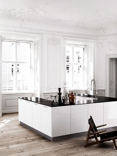 love this contemporary kitchen amidst the french provincial space