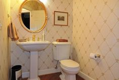Traditional Powder Room with Optum VorMax Complete Right Height 2-piece 1.28 GPF Elongated Toilet in White, Hardwood floors