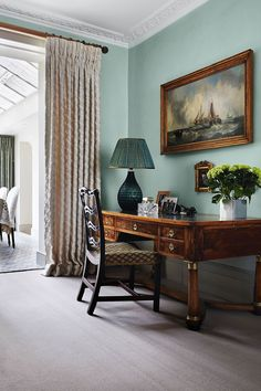 A hand-painted Irving & Morrison lamp brightens a corner of the drawing room; the herringbone wool carpet is from Roger Oates