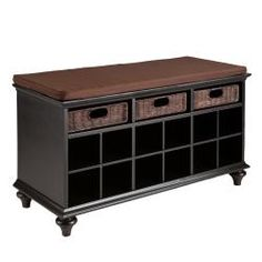 Cushion-topped shoe storage bench with twelve compartments and three rattan baskets. Product: Storage benchConstruction Material: Hardwoods, MDF, veneer and rattanColor: Black and brownFeatures: Twelve compartmentsThree baskets Dimensions: H x W x D Black Storage Bench, Shoe Cubby, Entryway Shoe Storage, Bench With Shoe Storage, Entryway Decor, Entryway Ideas, Entryway Furniture, Storage Shelves, Black Bench