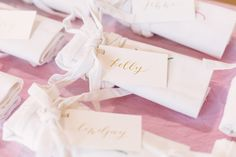 gold calligraphy name tags tied to aprons for each guest at a spring floral workshop in Milwaukee, WI