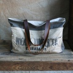 canvas salvaged from a WWII era Swedish military duffel paired with a 1940's era work apron and transformed into a sturdy everyday carryall- wow. $210 and one-of-a-kind #bag #purse #vintage