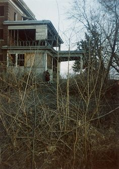 Mudcura Sanitarium (nicknamed Hell House), Shakopee, MN - abandoned and inundated with ghostly stories. It has been set on fire several times and now nothing of it remains but metal gates along the highway (according to website). Click for more pics and info..