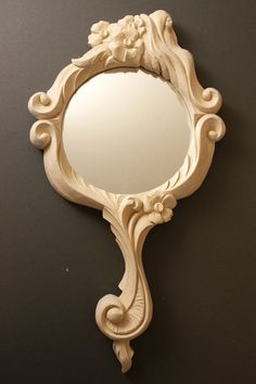 Hand mirror carved in birch 20cm x 40cm