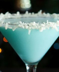 Got this recipe from Felicity Huffman's website.  Mmmmmm!  Ingredients: - 4 ounces of vanilla vodka - 4 ounces of Malibu Rum - 4 ounces of Coco Lopez Coconut Milk - 1/2 an ounce Blue Curacao