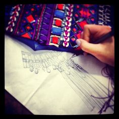 """""""Sketching neckline embellishment #atelier #studio #embroidery"""" As snapped by Matthew Williamson on Instagram."""