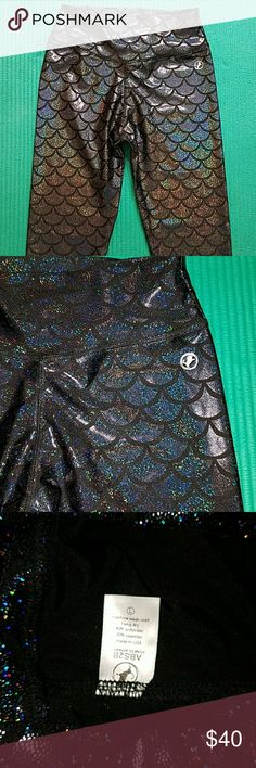 ABS2B Black Sea Leggings Large These are a pair of long leggings in a size large. They are 80% Nylon & 20% Spandex. They have a regular rise for this particular brand. They don't have the scrunch or the V band. The print is an amazing mermaid or scale foil holographic sparkle.  They really shine, but don't feel like the print is going to rub off.  Never worn. No stains, holes, or odors. The seams look great. By Abs2b Fitness Apparel. 100% non see through according to vendor's website.Sweat…