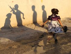 Palestinian children cast shadows on a wall in the Askar refugee camp, near the West Bank city of Nablus during an Eid al-Fitr celebration on Aug. Eid Al Fitr Holiday, Eid Al Fitr Celebration, Eid Festival, School Essay, Silhouette Photography, Girl Running, Photo Essay, Photography Projects, Student Work