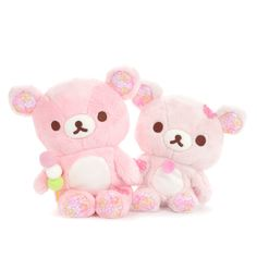Keep a token of spring's beauty year round with these lovely plushies of the cuties Rilakkuma and Korilakkuma! This time around, their soft boa fur is tinted a rosey pink, as they were specially made to incorporate sakura blossoms throughout their design. Other key points include the sakura blossom patches on their ears and feet, and their little handheld trinkets, which also happen to be detacha... #tokyootakumode #plushie #Rilakkuma