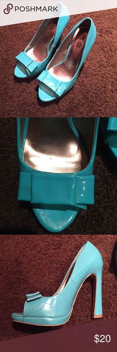Charlotte Russe pump Teal peep-toe pump with bow. 4 inch heal with 1/2 inch platform. Worn once. Charlotte Russe Shoes Platforms