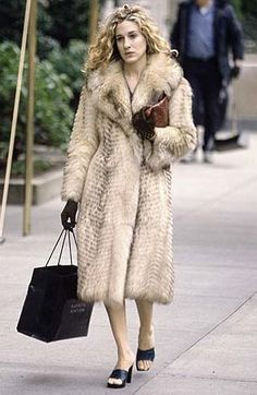 Pin for Later: Carrie Bradshaw's 60 Most Memorable Outfits Season One Carrie was loyal to her fur from day one.