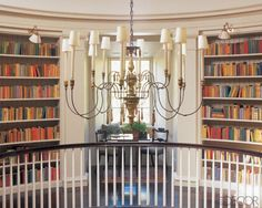 Bookcase Styling Ideas We Stole From the Pros : Books do double duty in this circular hall by adding color and pattern to an otherwise traditional space.  Source: Elle Decor