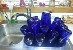 How to EASILY remove bottle labels for garden crafts (Nancy Carter's sink full of bottles)
