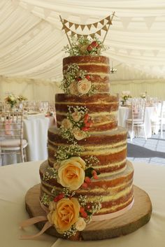 Neat finish rustic naked wedding cake with peach and cream roses. Wedding | Cemlyn Cakes | Portishead | Church Stretton