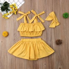 This sunflower yellow skirt set is perfect for summer.We're calling it right now - mustard yellow IS the new black. This adorable three piece clothing set is a must have boho outfit for your baby girl. Cute Baby Girl Outfits, Baby Outfits Newborn, Cute Baby Clothes, Little Girl Dresses, Kids Outfits, Girls Summer Dresses, Newborn Clothing, Girl Clothing, Winter Dresses
