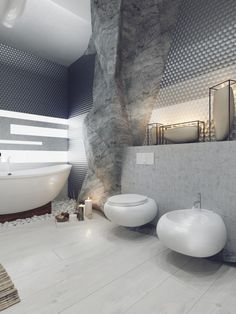 Rustic Meets Modern Home Decor Design: This bathroom is a visualization of a bathroom carved into rock, giving the space the feeling and appearance of being located in a cave. The craggy walls stand in contrast but also harmony with the smooth ceramic fixtures, which represent the way in which natural caves and rocks are worn away to a shine over thousands of years.