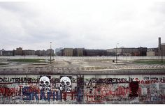 April 29, 1984: Graffiti is painted on the west side of the wall, while East German and Soviet flags fly on the other side